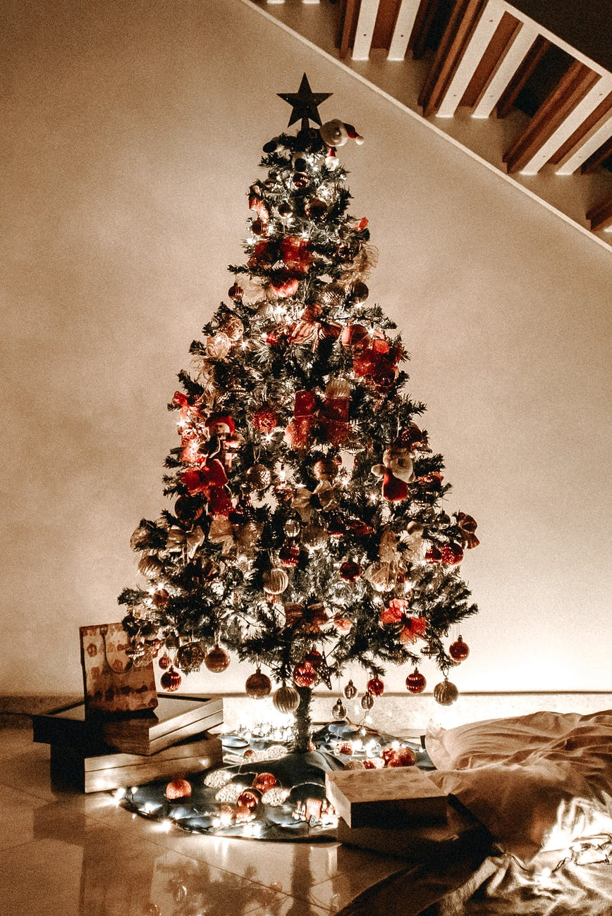 christmas tree with decors under the staircase